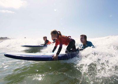 Young surfers catch wave at Malibu Makos